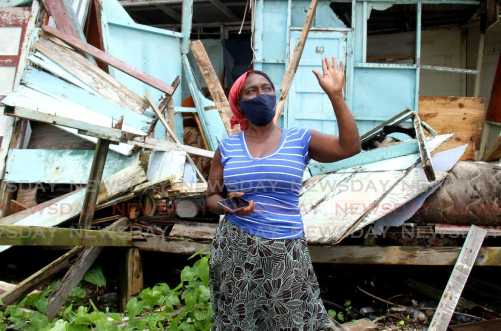 Catherine George raises her hand in prayer after her home was destroyed by high winds and torrential rain in Queen Street, La Brea - Photo by Ayanna Kinsale